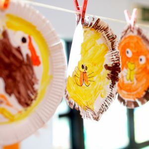 Cocoon Childcare - Children's paintings hanging to dry