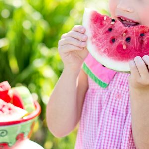 Cocoon Childcare - Girl eating watermelon