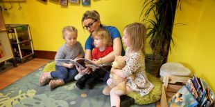 Cocoon Childcare staff reading to children