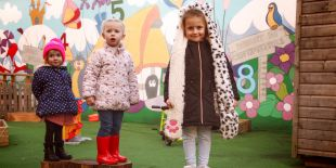 Cocoon Childcare – Children playing in the garden