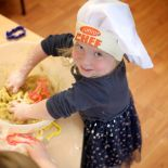 Cocoon Childcare - Child play cooking