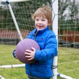 Cocoon Childcare - Boy playing football